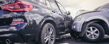 car crash involving front end and side impact on the road
