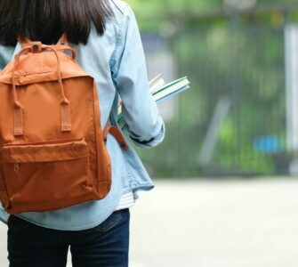college student wearing backpack